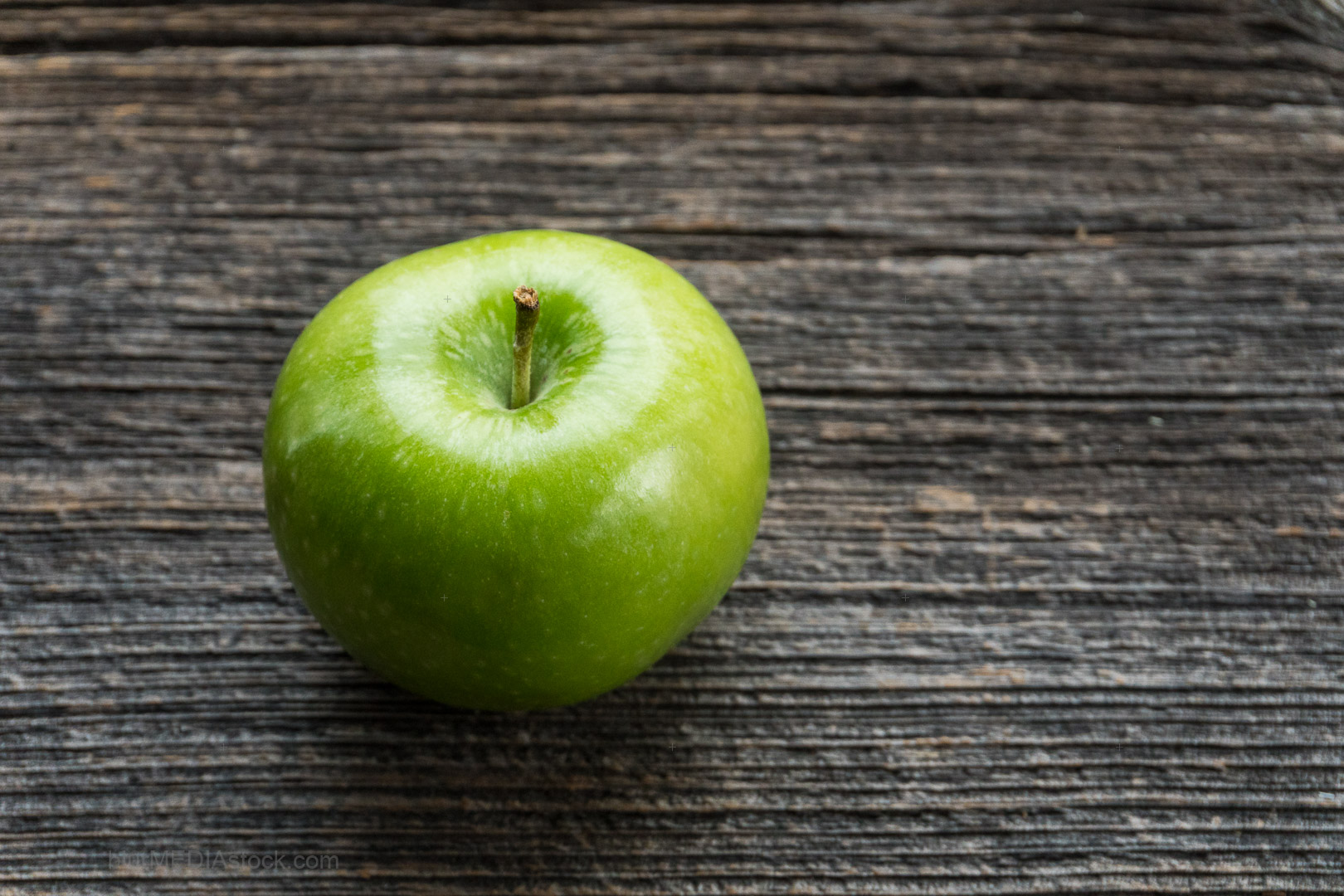 Green Granny Smith Sour Apple on Vintage Barn Board With Copyspa